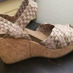 Adam Tucker wedge sandals.